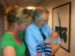 20-day-old Helge, his mother and Dr. Nugent